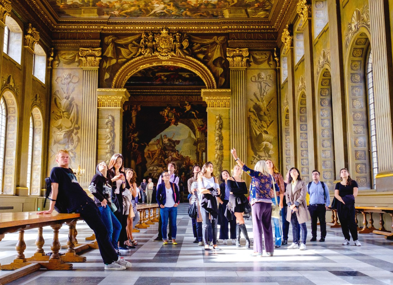Art and Business students admiring the Painted Hall in Greenwich, London >